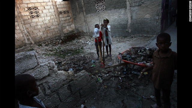 Children clear debris from a residence on March 1, 2011, in the Cité Soleil slum in Port-au-Prince.