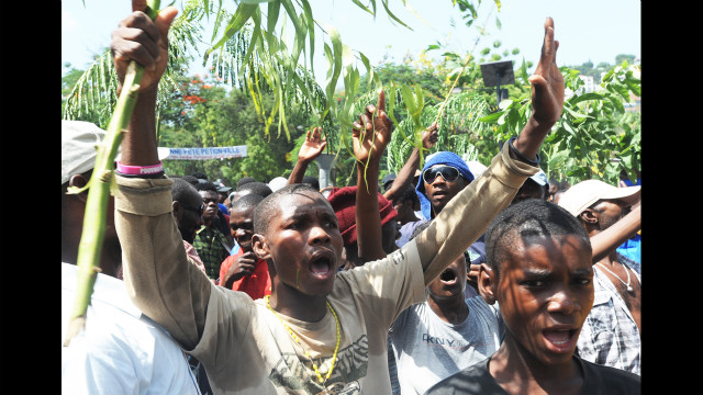 Residents of the hillside slums protest their planned destruction on July 12.