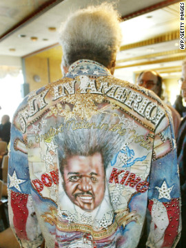 King shows off his &quot;Only in America&quot; denim jacket at a 2003 press event. While he publicly embraces the caricature of himself that he has spent decades creating, King is often quiet and deep in his thoughts when he's out of the limelight, according to his son, Karl.