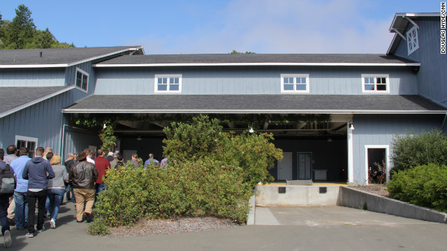 You'd never know it by looking at it, but inside this unassuming blue barn on George Lucas' famed Skywalker Ranch are some of the most iconic props in movie history. A group of hard-nosed journalists heads in, about to be reduced to giddy children.