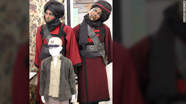 "Mannequins of two Thuggee cult members and the costume of Indy's sidekick, ""Short Round,"" from 1984's ""Indiana Jones and the Temple of Doom."""