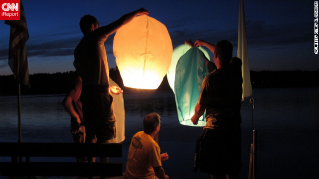 "iReporter Cindy Schultz and 26 of her family members made a summer trip to her brother's lakeside house in Minnesota, where they lit paper lanterns and watched them beautifully float over the lake. ""We talked in whispers as we watched them,"" she said. ""They puffed up into the sky like bags of microwaveable popcorn.""<br/><br/><a href='http://ireport.cnn.com/docs/DOC-829842' target='_blank'>Read more about their illuminating summer highlight on Cindy Schultz's iReport</a>."