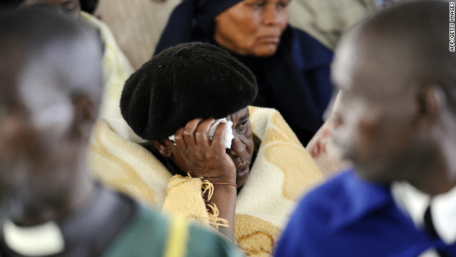 A woman mourns during a memorial service for the 44 people killed at Lonmin's Marikana mine on Thursday. 