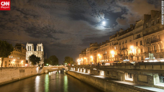 "Deciding to take a walk along the river Seine on his first night in Paris, Thomas Kelly says it was amazing to see a full moon breaking through the clouds as it illuminated the walkways. ""This scene really captures the essence of romance of one of the world's greatest cities,"" he said.<br/><br/><a href='http://ireport.cnn.com/docs/DOC-830519' target='_blank'>Read more about Thomas Kelly's trip to the City of Lights on his iReport</a>."