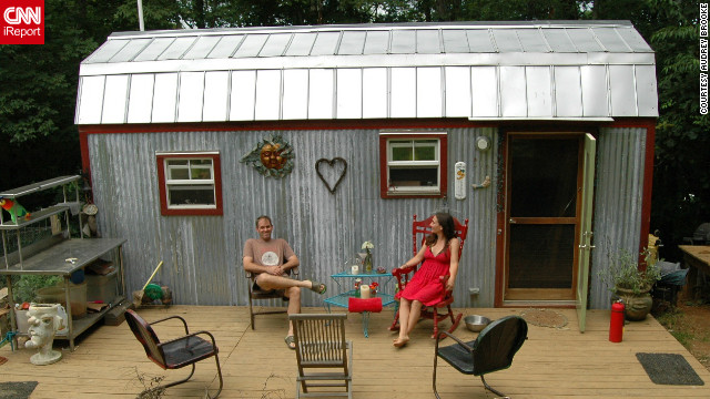 "Downsizing from a 1,500-square-foot house to a tiny 168-square-foot dwelling in Floyd, Virginia, Hari Berzins says she loves the freedom when it comes to tiny living. ""We live larger on our 3-acre hillside,"" she said. ""We have more time to enjoy each other, tend to our large garden and cultivate a supportive community.""<br/><br/><br/><br/>See more photos of their charming home on Hari Berzin's iReport."