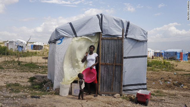 Mirlene Similien, 22, and her child live in a camp outside Port-au-Prince, established for people who were affected by the 2010 earthquake.