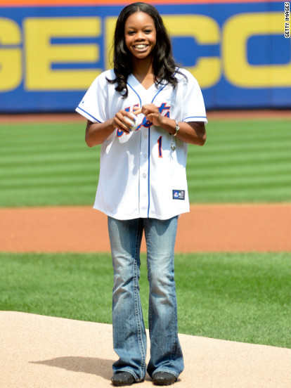 Gold medalist Gabby Douglas throws the first pitch at Citi Field.