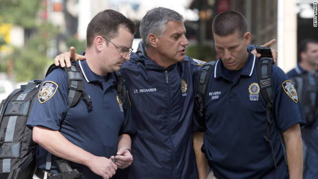 New York police confer at the shooting scene. 