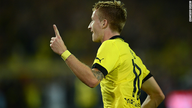 Marco Reus celebrates Borussia Dortmund's opening goal in a 2-1 win over Werder Bremen at the Westfalenstadion on Friday