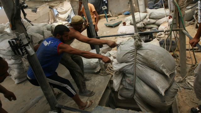 Palestinian workers in Gaza hoist goods out of a tunnel from the Egyptian side of the border last year
