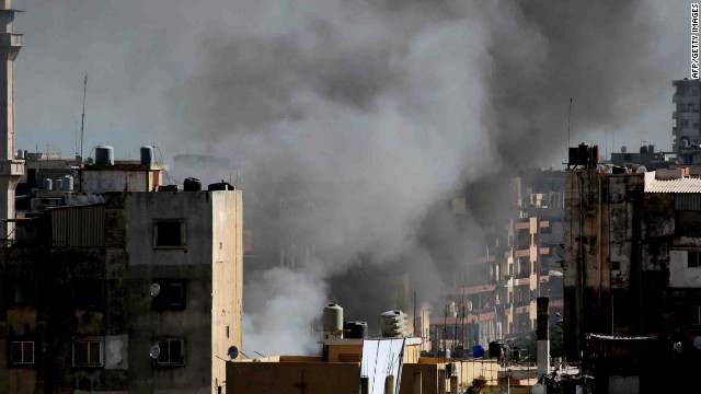 Smoke billows from a building in Tripoli, Lebanon.