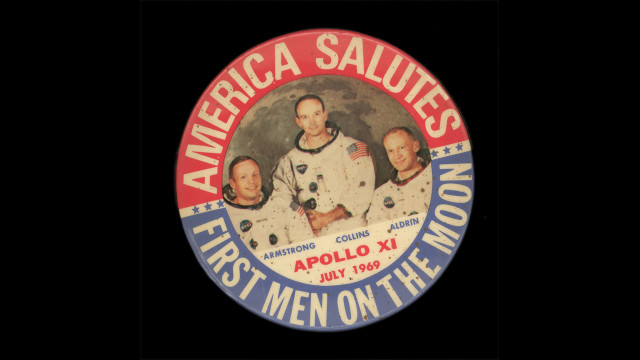 A commemorative button from 1969 celebrates the moon landing.