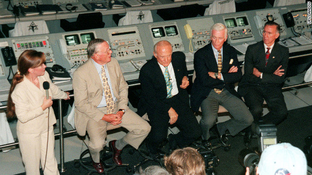 Former Apollo astronauts meet with the media at the Apollo/Saturn V Center prior to a 30th anniversary banquet highlighting the contributions of aerospace employees who made the Apollo program possible on July 16, 1999. From left to right: Armstrong; Aldrin; Gene Cernan, who flew on Apollo10 and Apollo 17; and Walt Cunningham, who flew on Apollo 7.