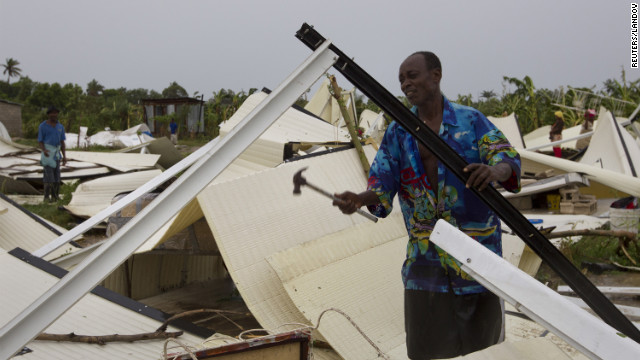 A man works to recover his belongings from his flattened home in a camp for displaced people in Port-au-Prince.