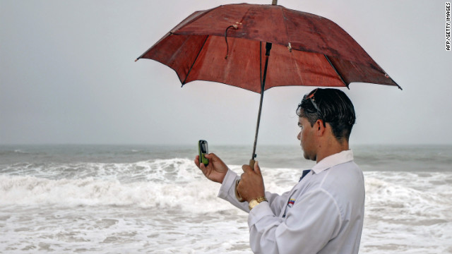 A man captures the effects of Tropical Storm Isaac in Gibara.