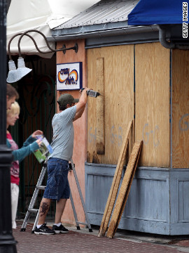 A Florida Keys resident boards up the windows of a store on Duval Street in Key West after a hurricane warning was issued ahead of Tropical Storm Isaac.