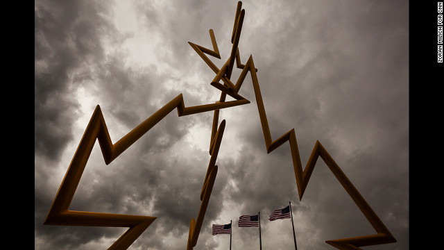 Storm clouds brew Saturday over the Lightning statue in Tampa. As Tropical Storm Isaac (now a hurricane) drew closer, officials decided to push back Monday's scheduled start of the RNC by one day. The storm took a westward path, however.