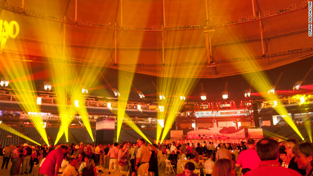 Convention-goers gather at Tropicana Field for a convention opening party Sunday night.