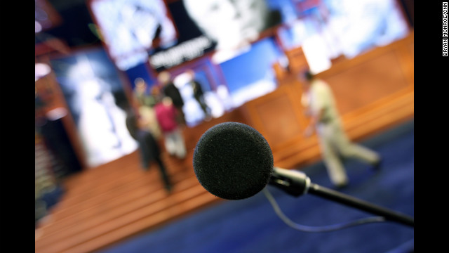 A microphone is in place at the front of the convention hall in Tampa.