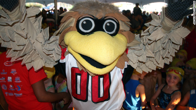 Mascot Freddie Falcon and Atlanta Falcon cheerleaders show up to cheer on the kids.
