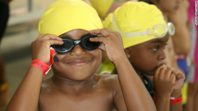 Lincoln Fletcher, 5, tightens his goggles before jumping in the pool.