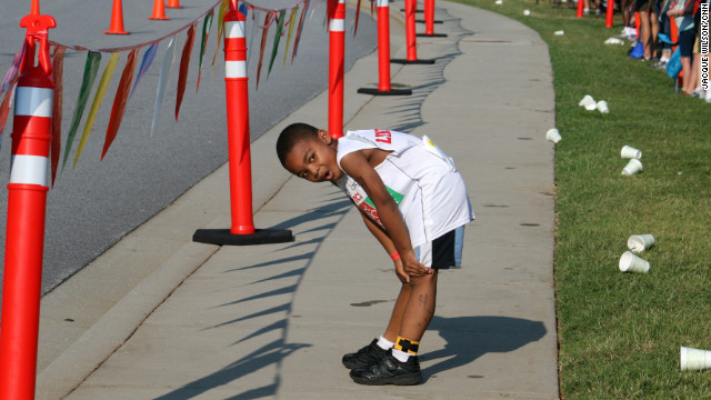 Lincoln Fletcher takes a minute to catch his breath before starting his half-mile run.