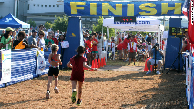 Supporters wait at the finish line with water and towels for the young athletes.