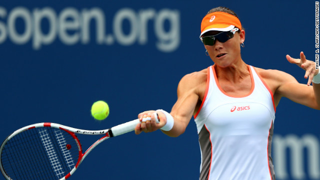 Samantha Stosur of Australia returns serve to Petra Martic from Croatia during her easy first round U.S. Open victory.