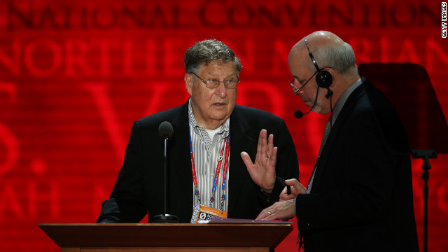 Former New Hampshire Gov. John Sununu, left, stands at the podium with stage manager Howard Kolins before events begin Monday.