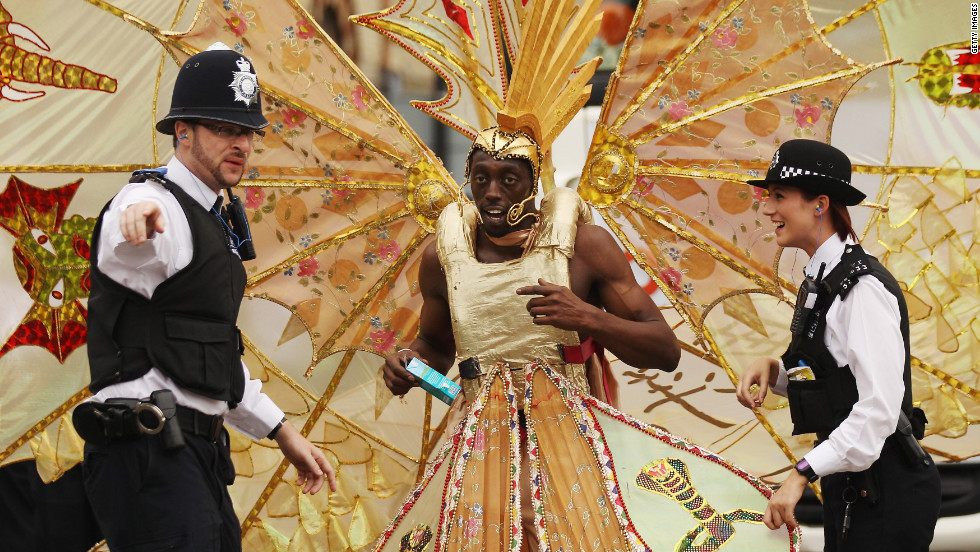 Police officers direct a participant at the Notting Hill Carnival in London on Monday, August 27. The annual two-day festival is billed as the largest of its kind in Europe and is expected to attract around 1 million revelers. It has taken place every August bank holiday since 1966.