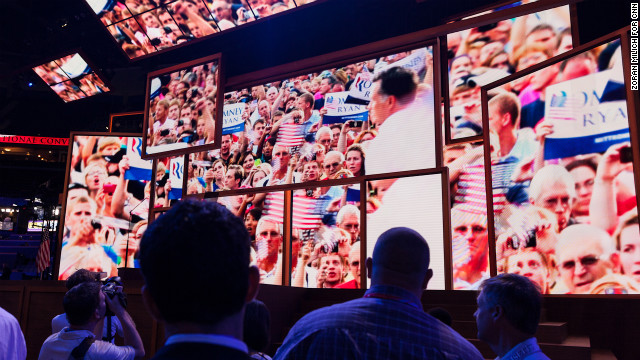 Images of Romney appear on the podium Monday at the gavel opening of the RNC.