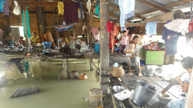 This photo taken last week by relief workers shows a family in Thabaung township in the Irrawaddy Delta taking refuge from the flood waters.