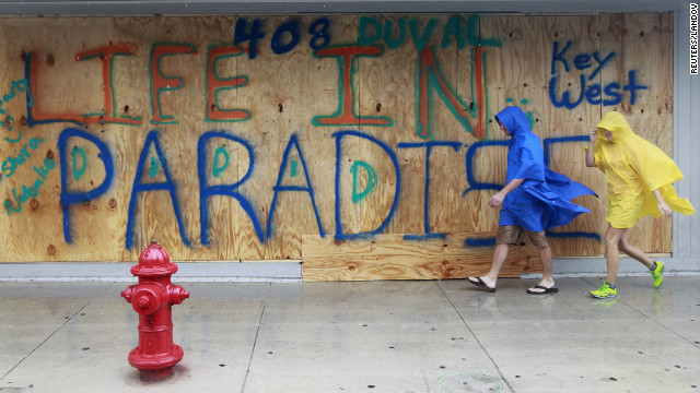Justin and Kayla Franklin of Tennessee walk in wind and rain in downtown Key West as Tropical Storm Isaac moves over the island.