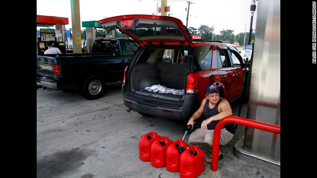 Ocean Springs, Mississippi, resident Charles Bartlett fills several gas containers in preparation for Tropical Storm Isaac.