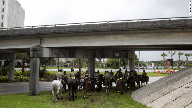 Mounted law enforcement officials wait out a brief rainstorm during the National Republican Convention. Commercial bus cancellations caused by Isaac prevented many of the expected demonstrators from being present.