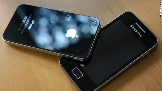 A picture taken on October 12, 2011, shows a Samsung phone, right, and an Iphone 4.