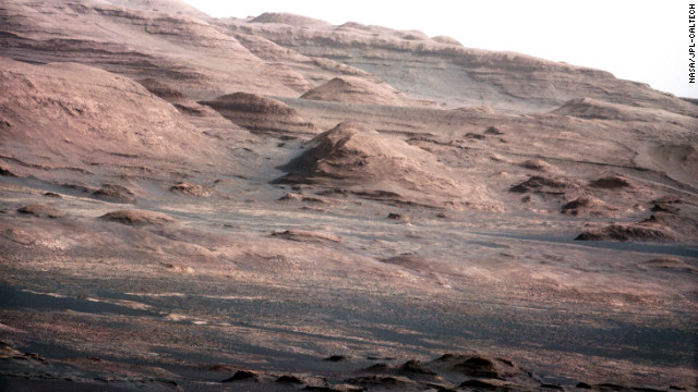 An image released August 27, 2012. was taken with Curiosity rover's 100-millimeter mast camera, NASA says. The image shows Mount Sharp on the Martian surface. NASA says the rover will go to this area.