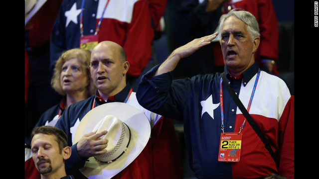 People from the Texas delegation say the Pledge of Allegiance.