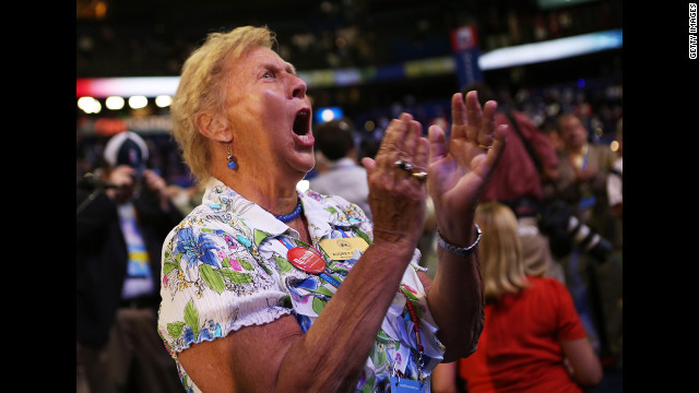 A woman cheers during the second day of the Republican National Convention.
