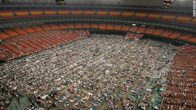 Evacuees crowd the floor of the Reliant Astrodome in Houston. The facility housed 15,000 refugees who fled the destruction of Hurricane Katrina.