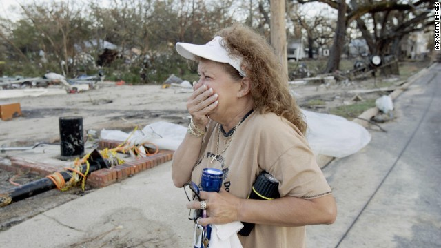 A woman cries after returning to her house and business, destroyed by Hurricane Katrina on August 30, 2005, in Biloxi, Mississippi.