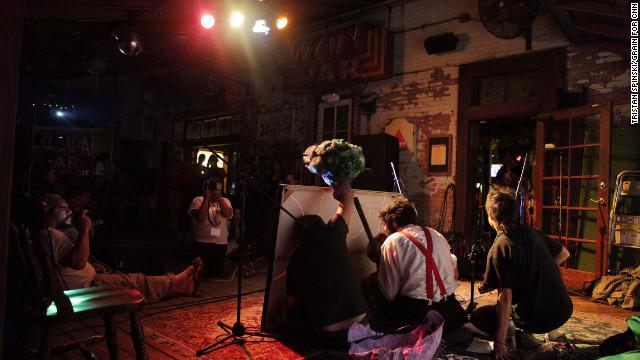 "Members of The Autonomous Playhouse, a troupe of puppeteers, perform ""Momma Nature vs. the Foreclosure Crisis,"" a puppet show about capitalism, foreclosures and the right to own a home, at New World Brewery."