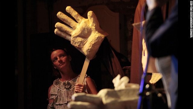 "Kathy Morris plays the role of ""Ann Momney"" as she controls the hands of ""Ritt Momney"" while the puppet engages in a mock political debate with Vermin Supreme, not pictured, at New World Brewery."