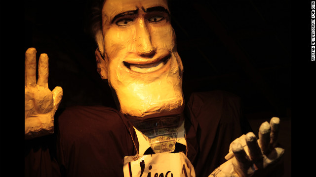 &quot;Ritt Momney,&quot; a giant puppet of Mitt Romney, engages in a mock political debate with Vermin Supreme, a performance artist and activist, at New World Brewery in the historic Tampa neighborhood of Ybor City following the first day of the Republican National Convention on Monday.