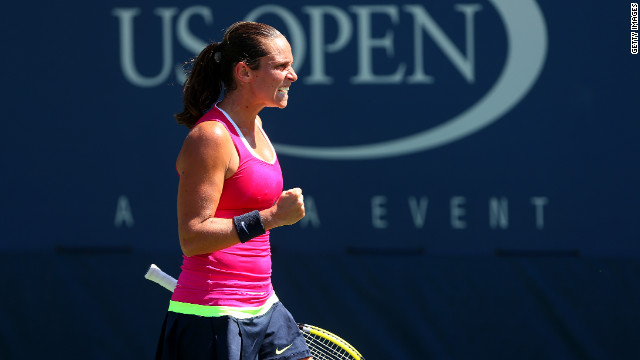 Roberta Vinci of Italy celebrates a shot against Urszula Radwanska of Poland.