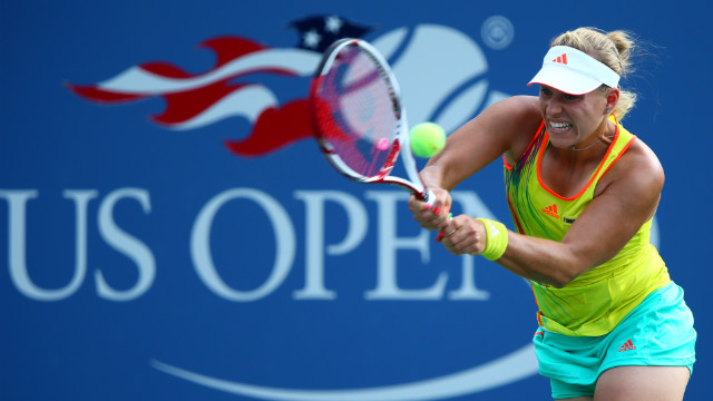 Angelique Kerber of Germany returns a shot during her women's singles first-round match against Anne Keothavong of Great Britain.