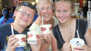 Sheila Evans and grandchildren Camron, left, and Rosa, right, dig into ice cream in Cincinnati, Ohio, where Evans picked Camron up for his week\'s vacation with her in Michigan.