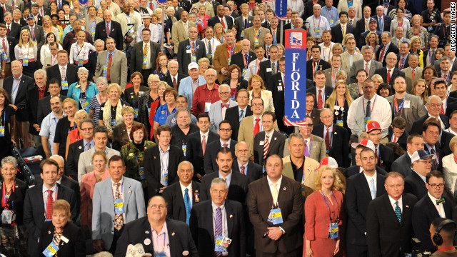 Delegates from host state Florida face photographers and cameras as they pose for the official convention photograph.