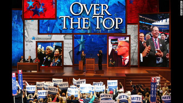 "People cheer as the screen displays ""Over The Top"" during the roll call of delegates."