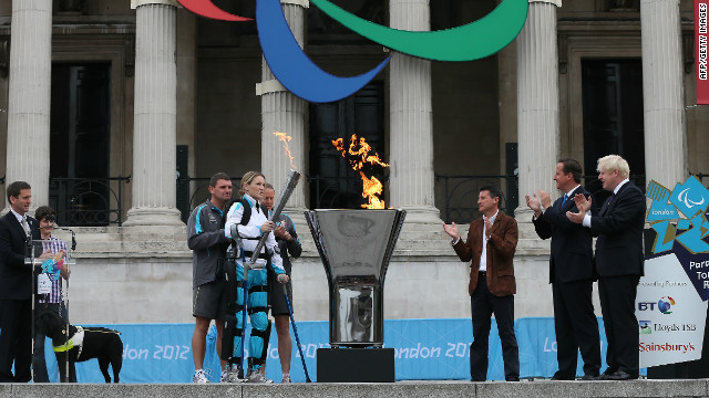 Disabled marathon runner Claire Lomas, center, lights the Olympic cauldron for the Paralympic Games in Trafalgar Square on August 24, 2012. The London 2012 Paralympic Games open on August 29 for 12 days.